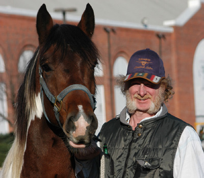 Frank Weller with Toby, the first PMU foal he rescued, pose at Equine Affaire, 2003.  Photograph courtesy of (C) Donna Cloutier, whose lyrical images grace the pages of the book, Equine Angels.