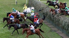 Synchronized riden by Tony McCoy, centre, wearing green silks with yellow bands, falls after jumping Becher's Brook. Photo: SCOTT HEPPELL / AP