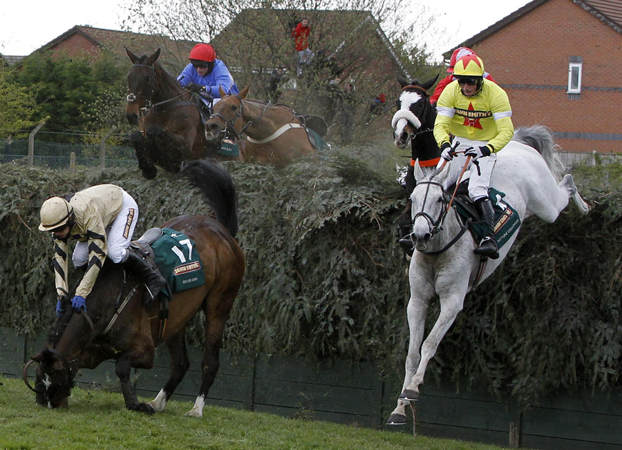 Neptune Collonges and Daryl Jacob clear Becher's Brook as On His Own falls. ESPN UK image.