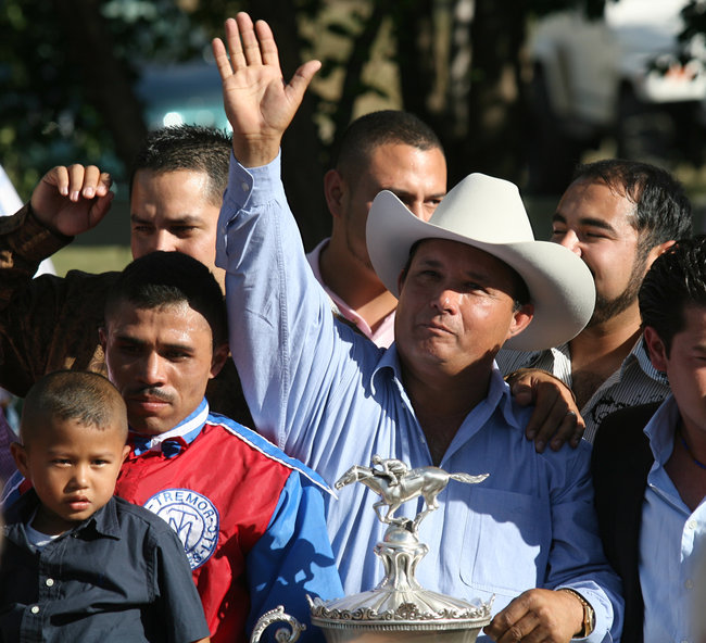 Brother of top drug ring enforcer José Treviño Morales with QH winning trophy.