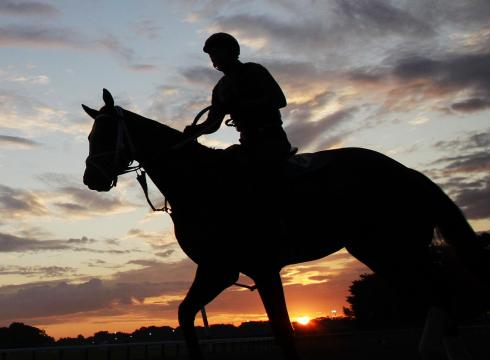 Silhouette of Racehorse and Rider. Mark Lennihan / AP Image.