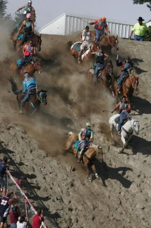 Horses charge down steep hill. Omak Suicide Race. World file photo/Mike Bonnicksen.