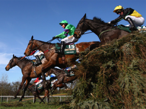 Grand National competitors jump Becher's Brook. Google Image.