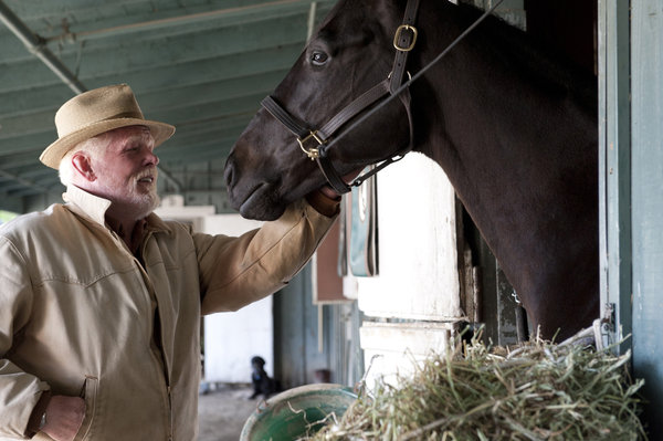 Nick Nolte with racehorse in HBO show Luck. AP Photo/Gusmano Cesaretti