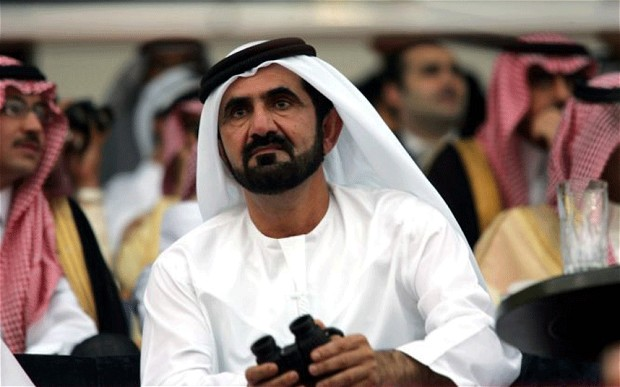 Sheikh Mohammed al-Maktoum in the stands at the races. He is now the central character of a huge racehorse doping scandal. AFP image.
