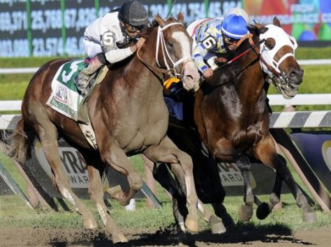 Will Take Charge, left, with jockey Luis Saez aboard, pulls past Moreno, with jockey Jose L. Ortiz up, to win the Travers Stakes at Saratoga Race Course in Saratoga Springs, NY. Photo by Hans Pennink / AP.