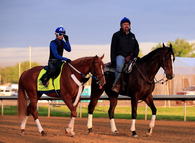 Steve Asmussen, right, the trainer with the second-most career victories, leads Kentucky Derby contender Tapiture during early morning workouts at Churchill Downs. Asmussen is under state and federal investigation over accusations of various forms of cruelty. Credit Jamie Squire/Getty Images.