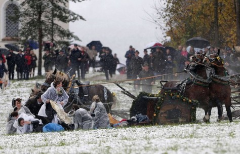 Several people were injured during an annual Catholic pilgrimage in Bavaria after the horses pulling their carriage bolted, toppling the wagon over and spilling passengers onto the snowy ground. Photo: AP.