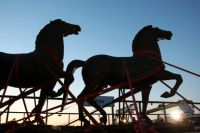 Two bronze horse statues by artist Josef Thorak are transported on a flatbed trailer in Bad Duerkheim, southwestern Germany, Thursday, May 21, 2015. Police in five states conducted coordinated raids during more than a yearlong investigation into illegal art trafficking. (Fredrik von Erichsen/dpa via AP)
