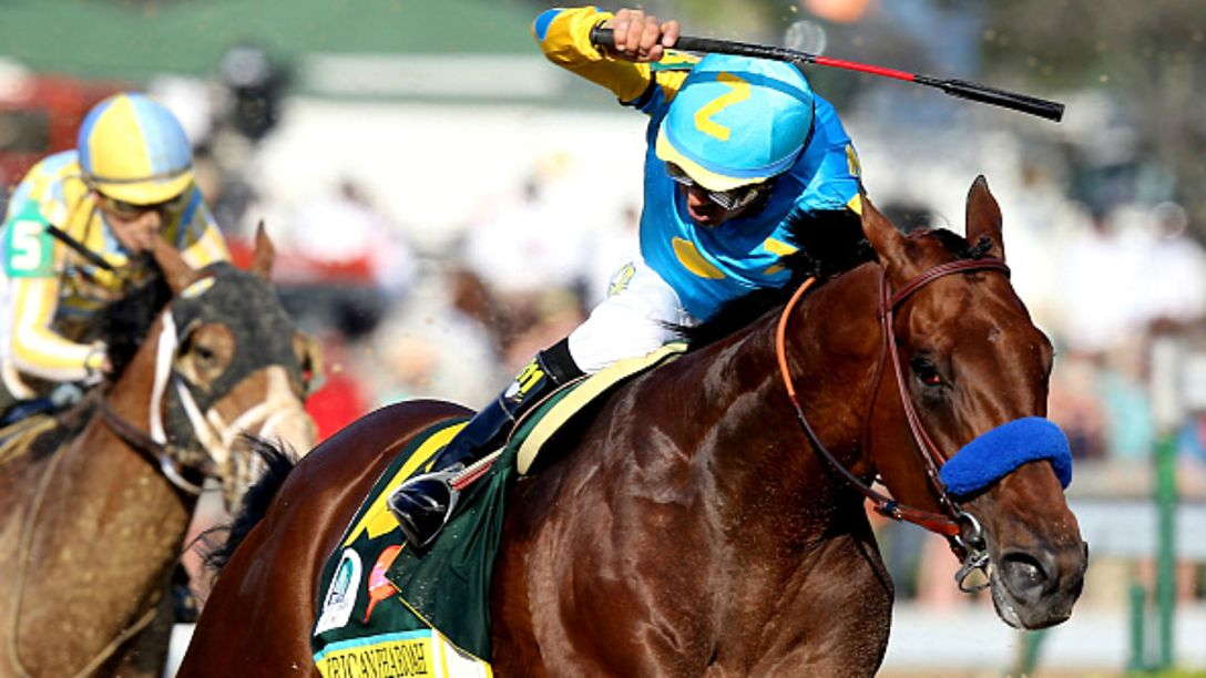 American Pharoah wins the Kentucky Derby on his way to the elusive Triple Crown. Getty Images 2015.