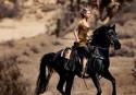 Jennifer Lawrence horses around in Vogue fashion shoot. November 2015.