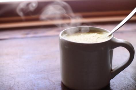 Steaming mug of warm milk.