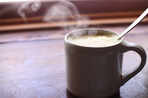 Steaming mug of warm milk.