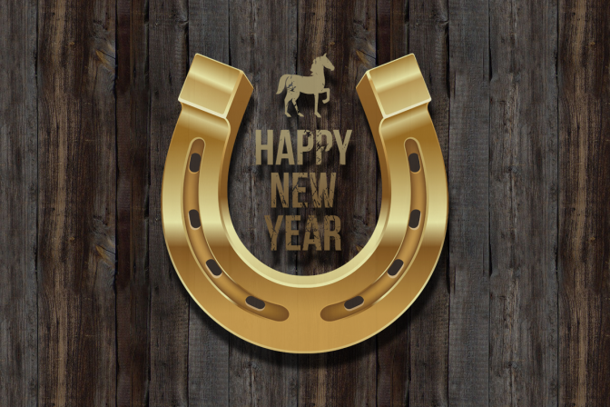 Happy New Year Horse and Golden Horseshoe against wood background.