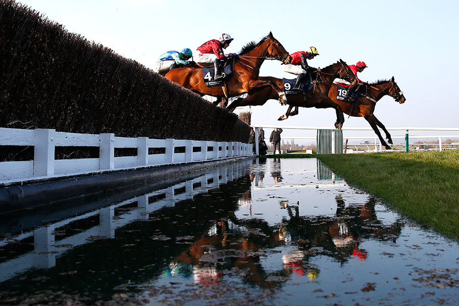 Sew On Target, ridden by Brendan Powell, Niceonefrankie, ridden by Charlie Deutsch, and Kings Palace, ridden by Tom Scudamore, race during the 4.10 Brown Advisory & Merriebelle Stable Plate during the Cheltenham Festival at Cheltenham Racecourse in England Thursday. Niceonefrankie died from injuries sustained in the race. Paul Childs/Action Images/Reuters