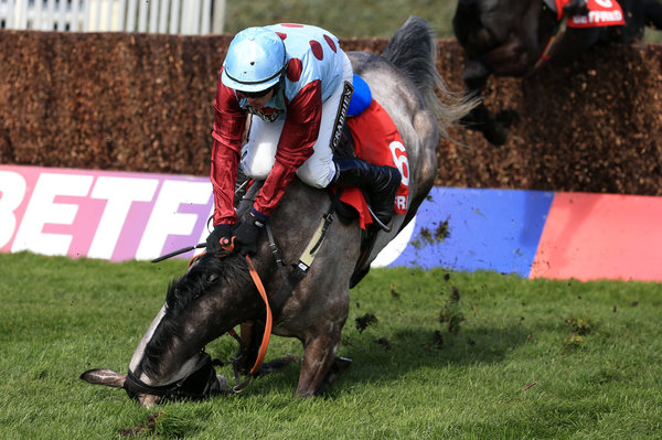 PHOTO: MIKE EGERTON / PA WIRE. Irish Cavalier ridden by jockey Paul Townend takes a fall during the Betfred Bowl Chase during the Grand Opening Day of the Aintree Grand National Meeting, Liverpool, England.