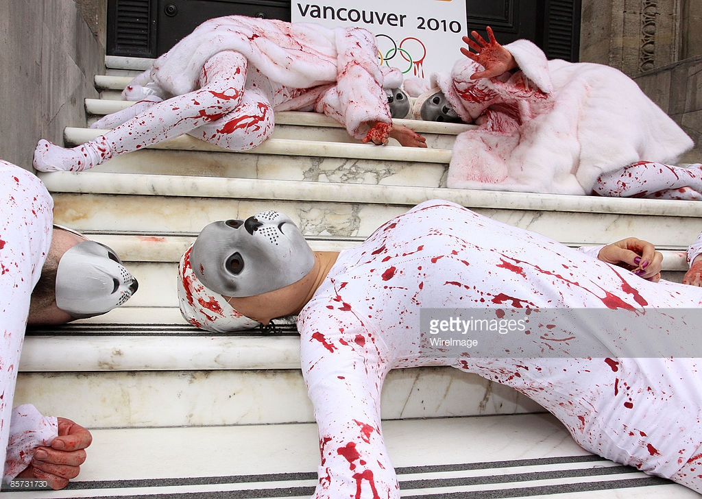 PETA protesters stage a Die-In against seal hunting with one protester draped in a white fur coat donated by Sex and the City star Kim Cattrall, at Canada House on March 31, 2009 in London, England.