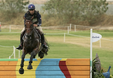 Astier Nicolas of France, riding Piaf De B'neville, jumps the last obstacle in the individual cross country equestrian preliminary at the Rio Olympics in Rio de Janeiro, Brazil, on Monday.	Gonzalo Fuentes/Reuters.