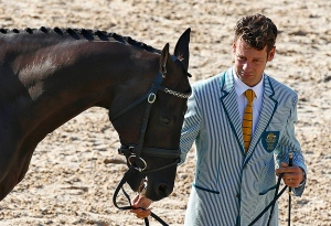 Christopher Burton of Australia stands with his horse Santano II during a Preliminary Equestrian inspection at the Olympic Equestrian Center on Friday. Tony Gentile/Reuters.