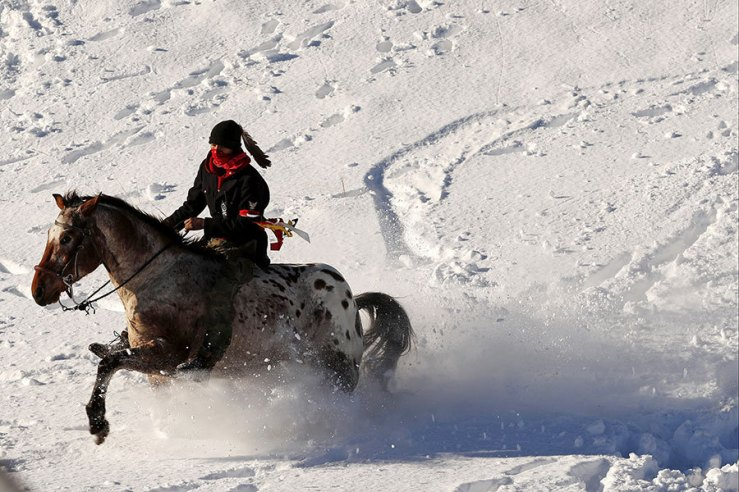 A young Native American man rides his horse through the snow near the Oceti Sakowin camp as 'water protectors' continue to demonstrate against plans to pass the Dakota Access pipeline near the Standing Rock Indian Reservation, near Cannon Ball, North Dakota. Lucas Jackson/Reuters.