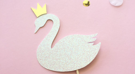 Glittery crowned swan cupcake topper.