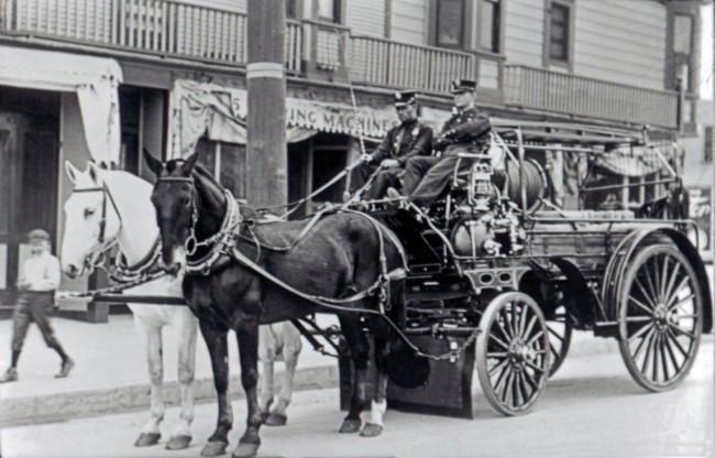 Horse drawn fire wagon.