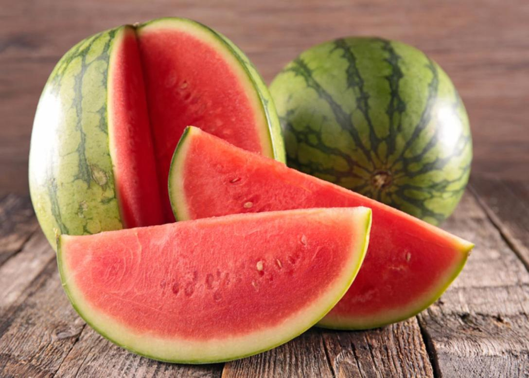 Round watermelon with slices. USDA.