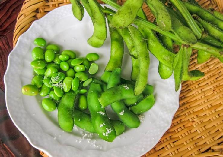 Edamame is a young soy bean that is harvested early. It contains complete protein, calcium, vitamin C, and other key nutrients.Edamame is a young soy bean that is harvested early. It contains complete protein, calcium, vitamin C, and other key nutrients.