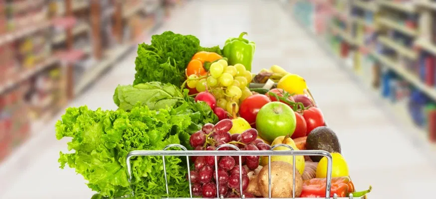 Grocery cart with fruit and veg.