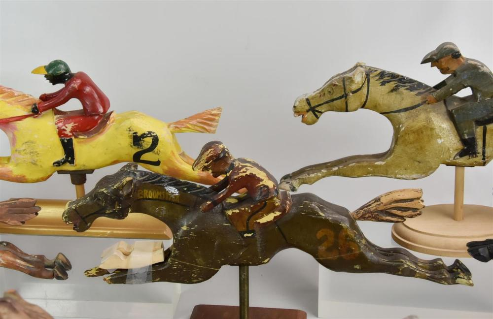 Carved racehorses.