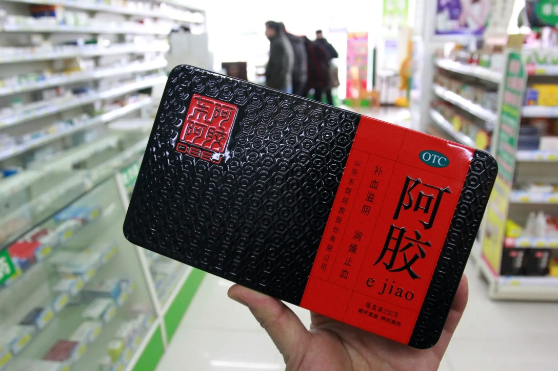 A customer shops for ejiao, or donkey-hide gelatin, at a pharmacy in Nantong, China. Photograph: Imaginechina Limited/Alamy Stock.