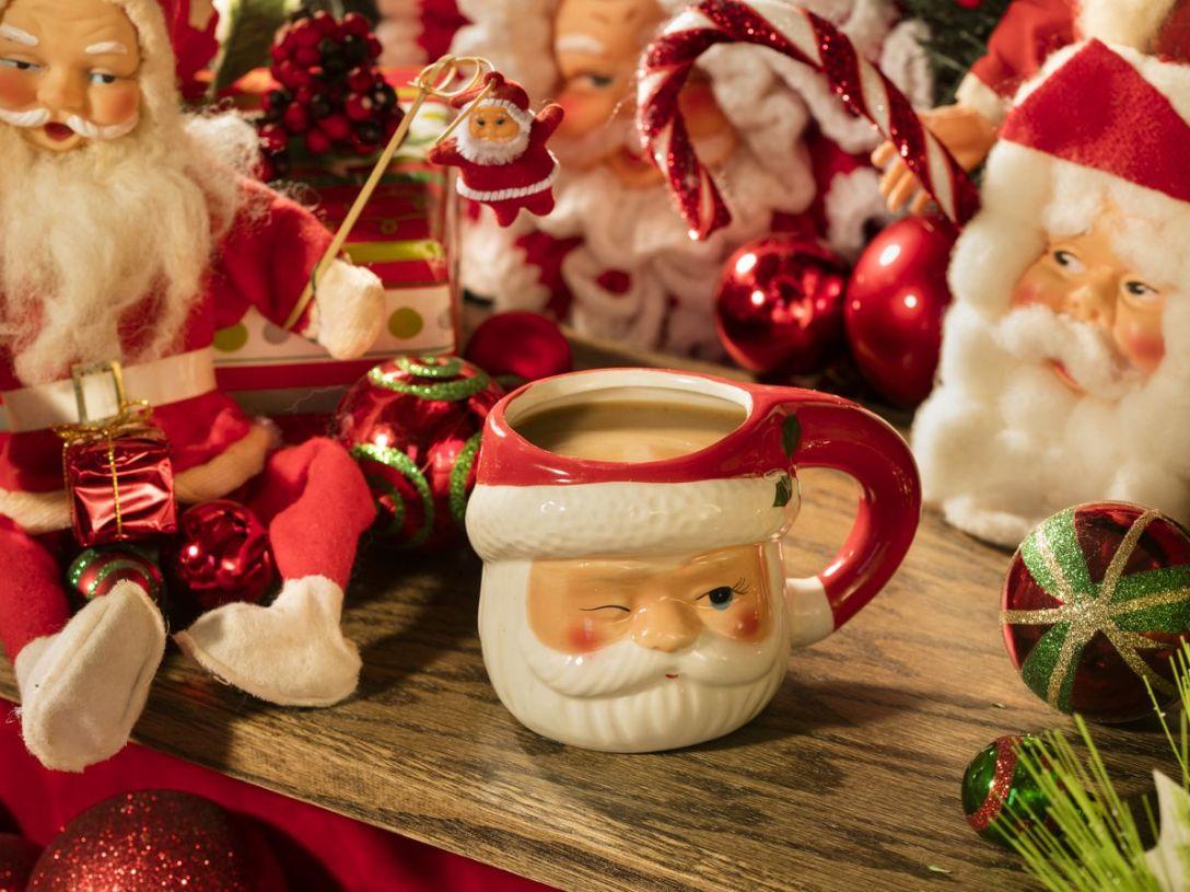 Collection of Santa mugs with egg nog.