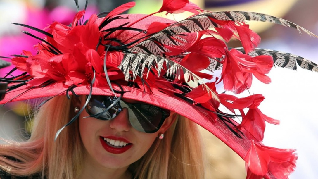 Beautiful lady wearing a gorgeous fashion hat at the Kentucky Derby 2019.